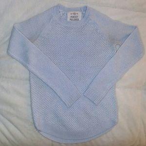 A light blue pullover